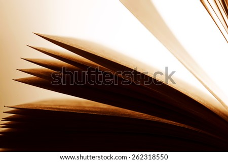 Open old book, pages fluttering. Fantasy, imagination, education concept. Vintage mood. - stock photo