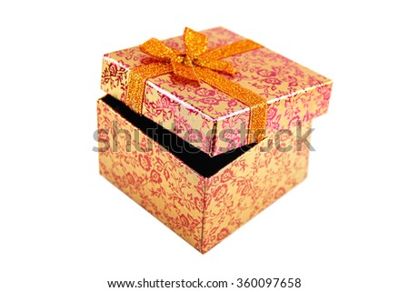 Open orange - metallic gift box with ribbon bow. Holiday present. Object isolated on white background. - stock photo
