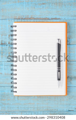 Open orange Notebook and pen  for text and background - stock photo