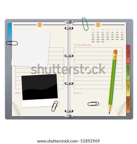 Open organizer with a green pencil, photograph and paper clips.