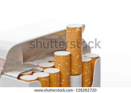 Open pack of cigarettes on a white background