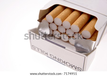 Open pack of cigarettes over white - stock photo