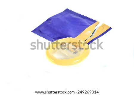 open pack of condom isolated on white background - stock photo