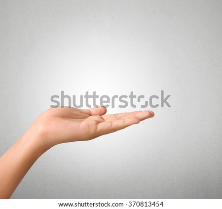 Open palm hand gesture of male hand - stock photo