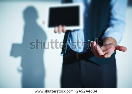Open palm of male employee with touchpad