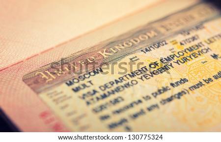 open passport, tourist visa - stock photo