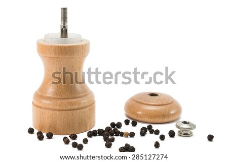 open pepper mill standing in pepper corns - stock photo