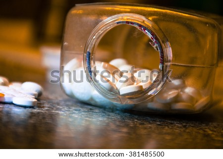 open pill bottle prescription drugs kills millions in america every year counter filled with tablets , gel tabs , and pills  - stock photo