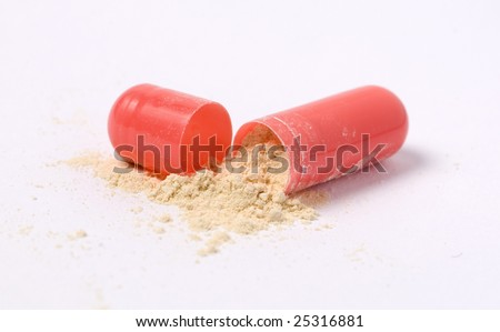 Open pill on white background