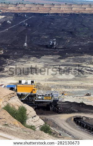 open pit coal mine with machinery and excavators
