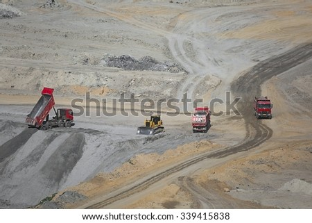 Open pit mining of coal wit waste pile - stock photo