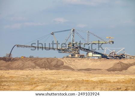 Open pit. Opencast brown coal mine. Giant excavator machinery. Extractive industry. - stock photo