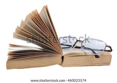 Open pocketbook and glasses isolated on white background with clipping path - stock photo