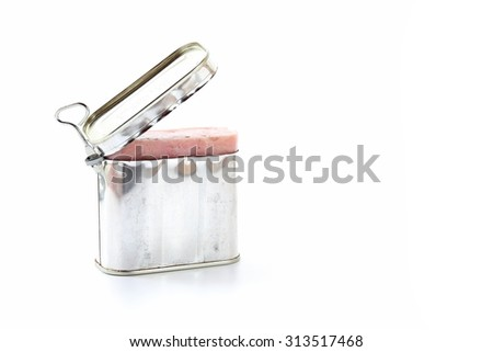 Open pork luncheon meat can with opener on white background.