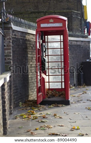 open public phone box on london street - stock photo