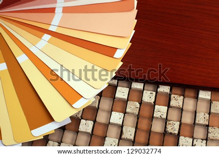 open RAL pantone sample colors catalog on wood and mix mosaic background - stock photo