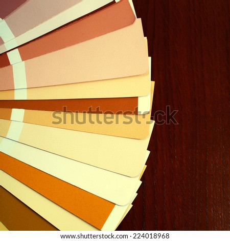 open RAL pantone sample colors catalogue on wood background - stock photo