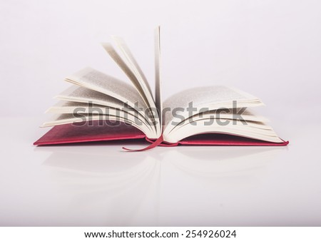 Open red book on white background - stock photo