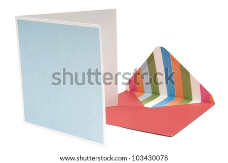 Open red envelope with card beside on white background. Clipping path included.