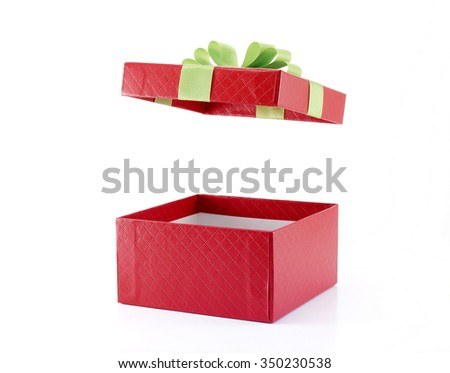open red gift box with green ribbon on white background