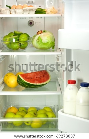 Open refrigerator full with some kinds of food - stock photo