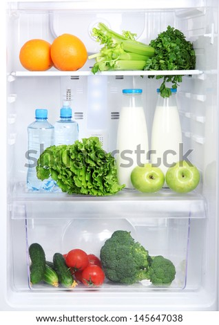Open refrigerator with vegetarian food - stock photo
