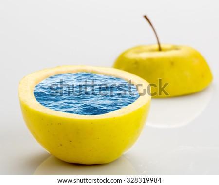 Open ripe apple full of water - stock photo