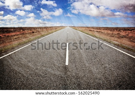 Open road in the Australian outback, western New South Wales.  Old photo grunge style. - stock photo