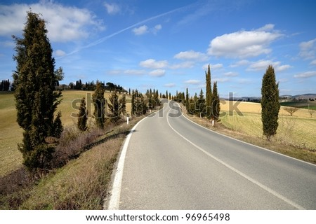 Open road in Tuscany in a sunny day - stock photo