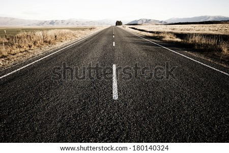 Open Road Leading to The Mountains, New Zealand - stock photo