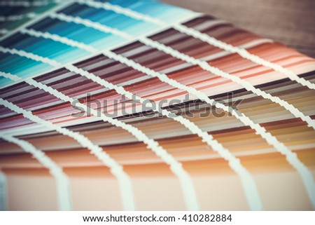 open sample colors catalogue. toned image - stock photo