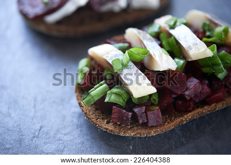 open sandwich with beet and herring - stock photo