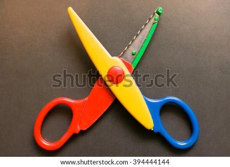 Open scissors for kids isolated - stock photo