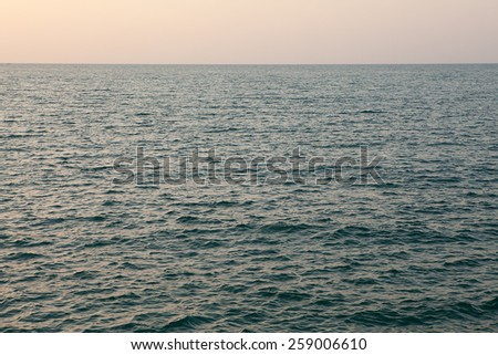 Open sea at sunset.