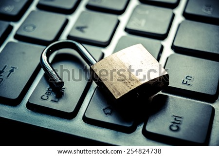 open security lock on computer keyboard - computer security breach concept - stock photo