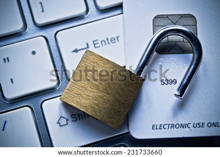 open security lock on credit cards with computer keyboard / credit card data theft concept - stock photo
