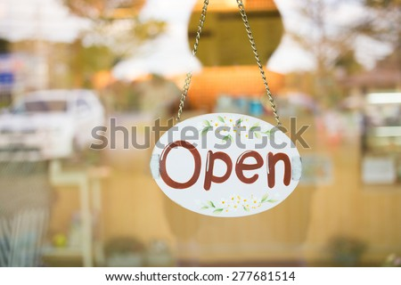open sign broad hanging on mirror door at coffee shop cafe - stock photo