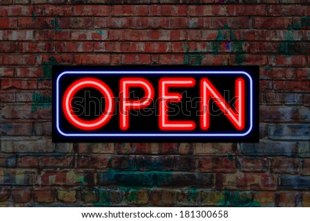 Open sign in Neon light on a gunge brick wall. Open for business - stock photo