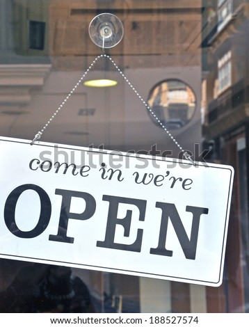 Open sign in the street cafe - stock photo