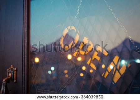 open sign on the door of jeans shop - stock photo