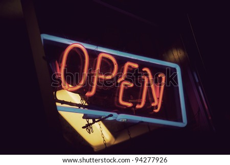 Open sign with red neon and blue frame - stock photo