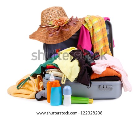 Open silver suitcase with clothing isolated on white - stock photo