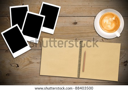 Open sketchbook with a lot of photos and cup of coffee - stock photo