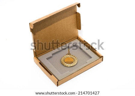 Open small cardboard box with gold medal inside