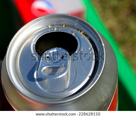 Open soda can with liquid drops on top - stock photo