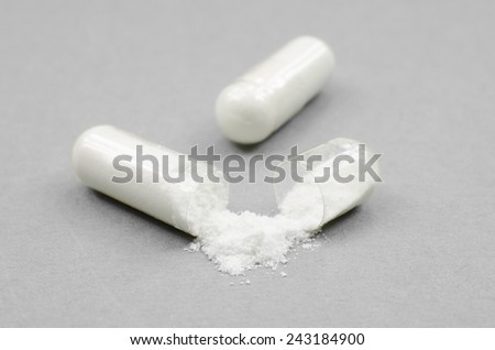 open soft capsule (vitamins) - stock photo