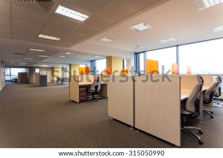 Open space with desks in the office - stock photo