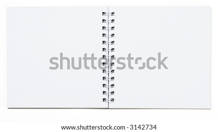 open spiral binding notebook on white