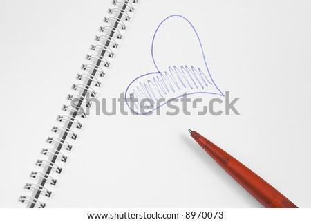 Open spiral notebook with red plastic pen and blue heart. - stock photo