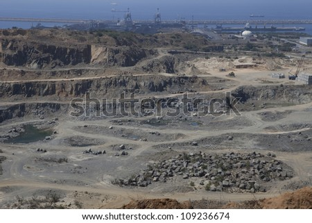 Open stone mine near the sea - stock photo